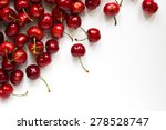 Small photo of Sweet red cherries isolated on white background