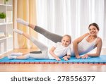 mother and daughter doing yoga... | Shutterstock . vector #278556377