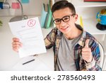 portrait of teenager sitting at ... | Shutterstock . vector #278560493