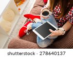 woman at home relaxing on sofa... | Shutterstock . vector #278640137