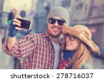 couple doing selfie outdoors.   Shutterstock . vector #278716037