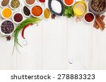 Various Spices On White Wooden...
