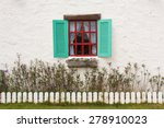 Blue Window In A White Wall