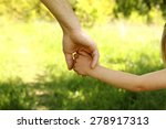 a the parent holding the hand...   Shutterstock . vector #278917313