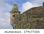 moss covered walls and tower of ...