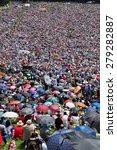 Small photo of CSIKSOMLYO, ROMANIA - JUNE 7: Crowds of Hungarian pilgrims praying during the Pentecost and the catholic pilgrimage on June 7, 2014 in Sumuleu Ciuc (Csiksomlyo), Romania