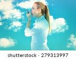 beautiful blonde using an... | Shutterstock . vector #279313997