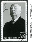 Small photo of UNITED STATES OF AMERICA - CIRCA 1998: A stamp printed in USA shows portrait of Sir Alfred Joseph Hitchcock (1899-1980), series Legends of Hollywood, circa 1998