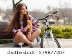 young woman drinking coffee on... | Shutterstock . vector #279677207