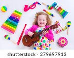 Child With Music Instruments....