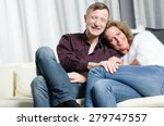 couple laughing on couch | Shutterstock . vector #279747557