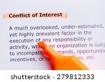 Small photo of conflict of interest word highlighted in the white background