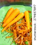 Four Peeled Carrots On The Tra...