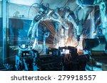 Team welding robots represent...