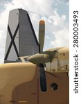 Small photo of Aircraft propeller airframe and tail with blue sky background. Vertical