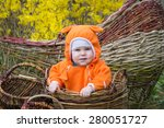 smiling baby girl in basket | Shutterstock . vector #280051727
