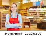 Small photo of Young happy smiiling woman doing apprenticeship in a supermarket
