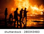Silhouette Of Firemen Fighting...