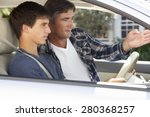 Small photo of Father Teaching Teenage Son To Drive