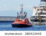 Tugboat At Sea With Wreck Ship.