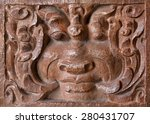 Textured Face On Bas Relief Of...