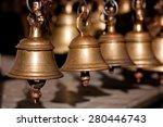 Brass Praying Bells Hanging On...