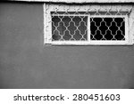 Small Window With A Grille And...
