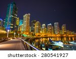 Stock photo skyline of the city of vancouver in canada at night seaplane airplane parked in the vancouver 280541927