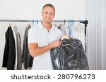 Young Happy Man Holding Coat I...
