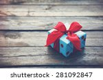 Gift Box On Wooden Table As...