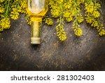 Rape Oil And Rape Blossoms On...