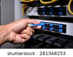 man connecting network cable to ... | Shutterstock . vector #281368253