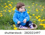 infant boy sit in grass | Shutterstock . vector #282021497