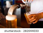 draft beer pour in a glass from ... | Shutterstock . vector #282044033