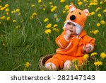 cute infant baby fox in basket | Shutterstock . vector #282147143