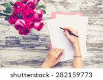 Woman Writing On  Blank Paper...