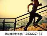 Stock photo healthy lifestyle sports woman running up on stone stairs sunrise seaside 282222473