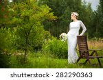 beautiful young bride standing... | Shutterstock . vector #282290363