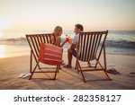 happy couple smiling at the... | Shutterstock . vector #282358127