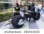 Постер, плакат: Batman cosplayers with a
