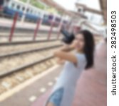 blurred woman using a camera on ... | Shutterstock . vector #282498503