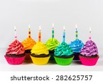 Rows of colourful cup cakes...