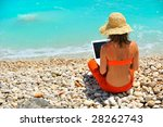 young woman using laptop on the ... | Shutterstock . vector #28262743