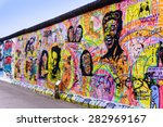 Stock photo berlin germany march graffiti at the east side gallery on march in berlin germany 282969167