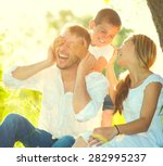 Happy Joyful Young Family...