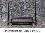 Bench Under A Stone Wall