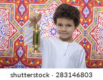 happy boy with golden lantern... | Shutterstock . vector #283146803
