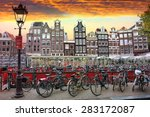 Stock photo amsterdam netherlands october sunset in amsterdam bicycle parking and traditional old 283172087