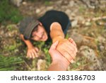 Small photo of Hand helping a man to raise after falling