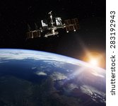 Small photo of Space Station Orbiting Earth. Elements of this image furnished by NASA